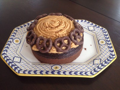 Chocolate cake with peanut butter, caramel icing and chocolate covered pretzels.